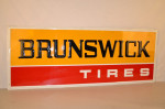 Brunswick Tires Single-Sided Tin Embossed Sign