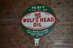 Wolf's Head Oil Double-Sided Tin Paddle Sign